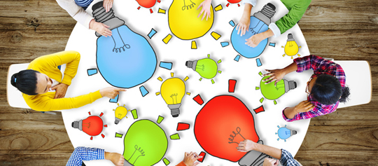 Multiethnic Group of People Meeting with Light Bulb Symbol